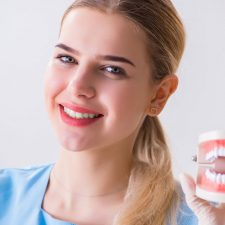 Smiling Girl having the Denture