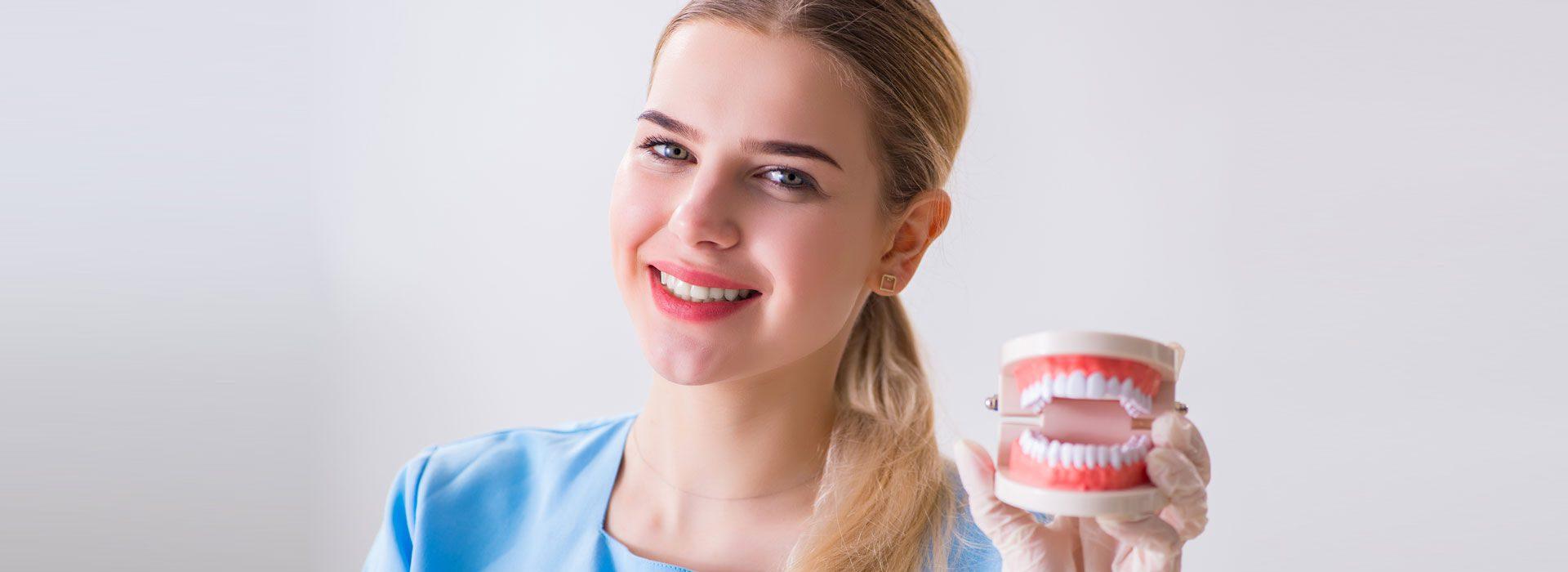 Smiling Girl having the Denture